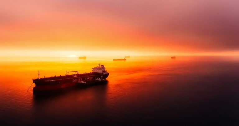 http://cargo%20ship%20out%20at%20sea%20overlooking%20sunset