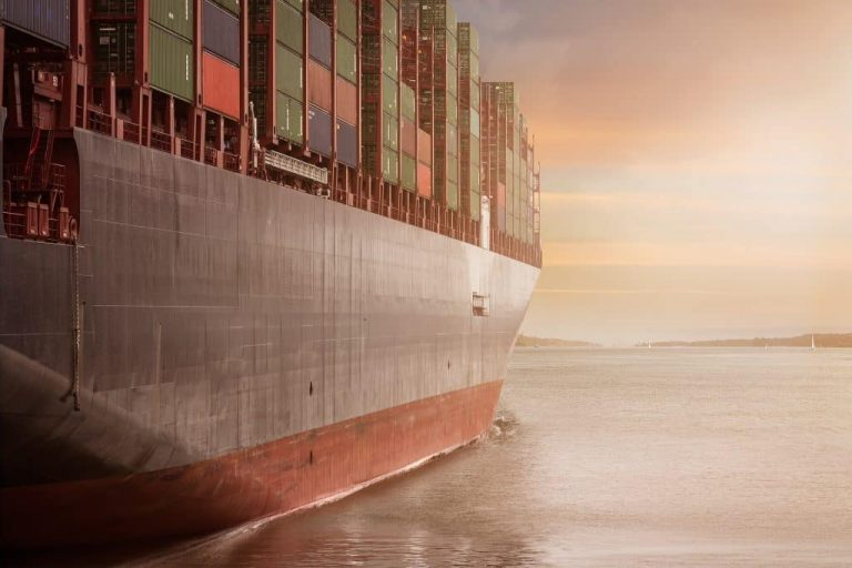 http://side%20view%20of%20cargo%20ship%20full%20of%20cargo%20at%20sea