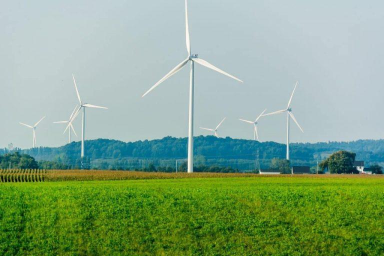 http://wind%20turbines%20in%20background%20overlooking%20fields