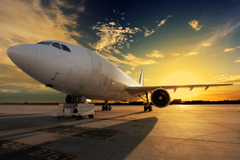 http://plane%20grounded%20at%20sunset